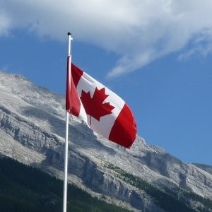 Canada flag with mountain in background