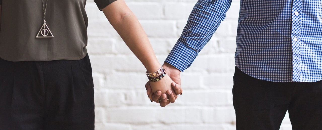 Couple in relationship holding hands