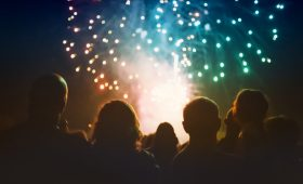 crowd-watching-end-of-year-fireworks-and-celebrating